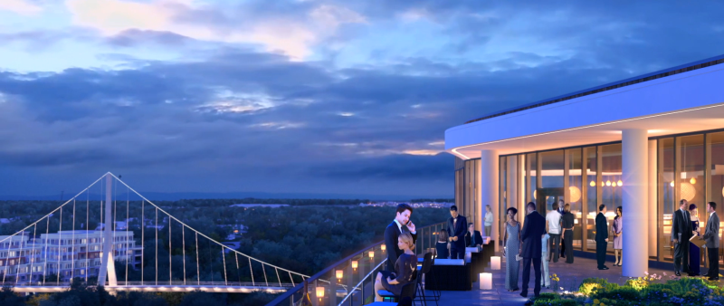 View of the rooftop bar at the AC Marriott at dusk overlooking the pederstrain bridge