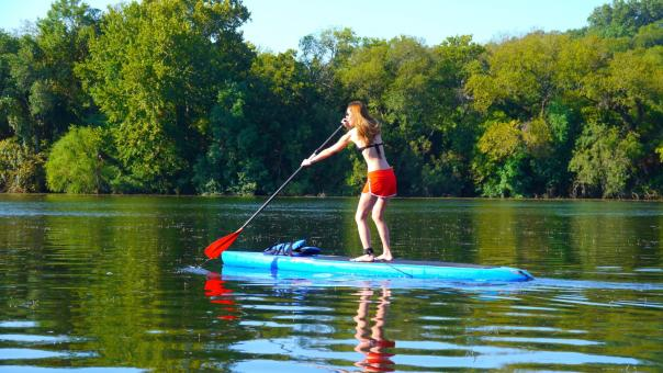 Woman paddle boarding with SUP ATX