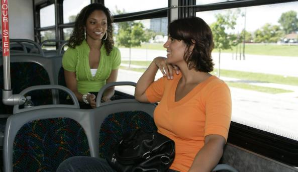 travelers on a RGRTA bus