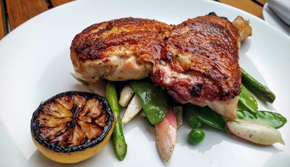 Roasted chicken with spring vegetables at Sessanta Ristoraute in Manhattan