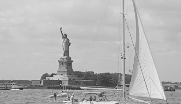Statue of Liberty with Sailboat in Foreground