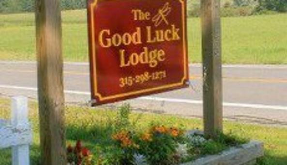 The Good Luck Lodge	Sign