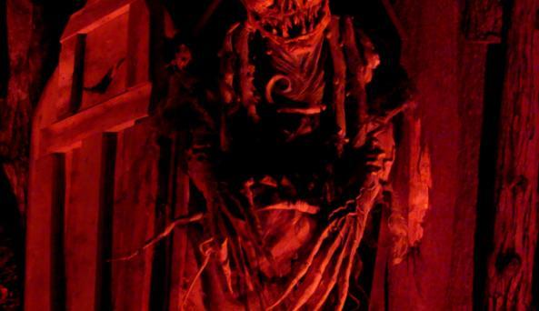 The Harvester waits at Night Terrors Haunted Farm.