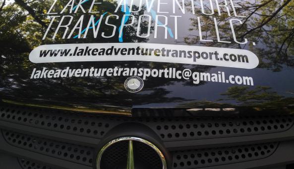 Lake-Adventure-Transport-Vehicle-logo-grille