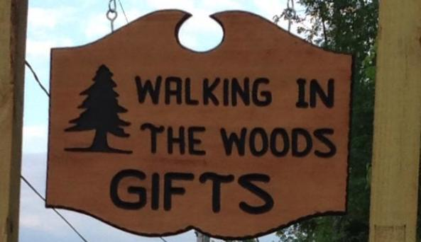 walking in the woods sign