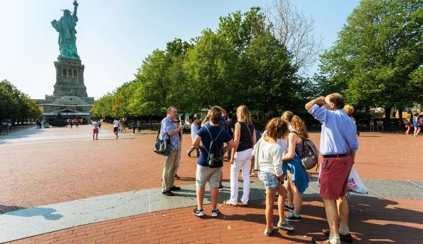 participants of Walks of New York visit the Statue of Liberty