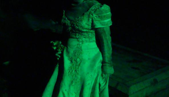 The woman in white, waits for fresh souls at Night Terrors cemetery.