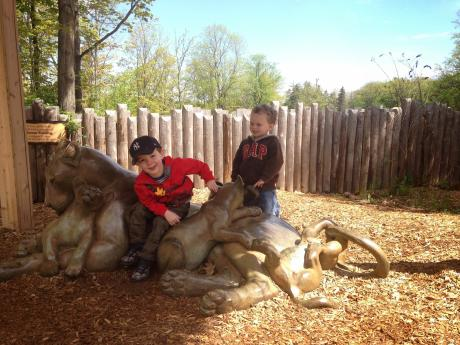 Two boys on lion statue at the Seneca Park Zoo