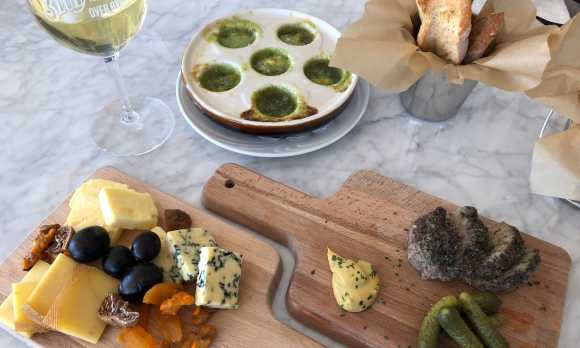 Cheese board and escargot