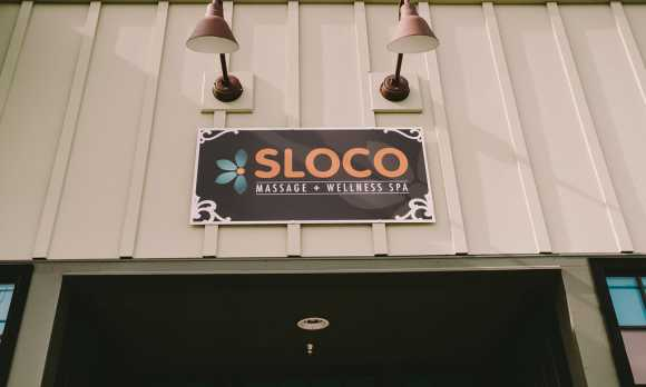 Sign for SLOCO Massage & Wellness Spa