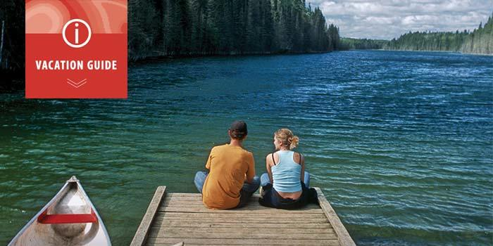 Download vacation guide, couple on dock, Canada Summer Games