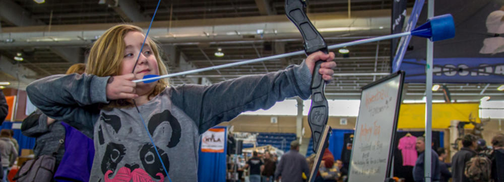 Youth bow practice at the Great American Outdoor Show