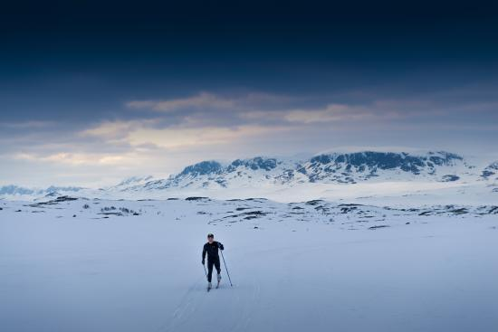 Cross country skier in front of Hallingskarvet mountain