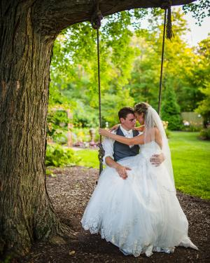 Helton couple on swing at Avon Gardens on wedding day