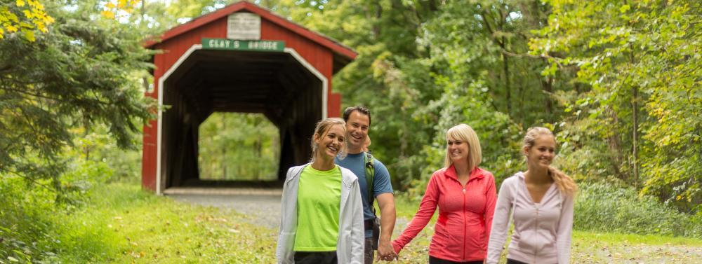hiking-walking-family-teens-outdoors-covered-bridge