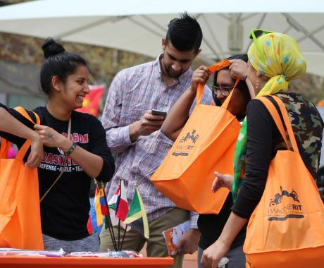 Visitors get their swag bags for all the Imagine RIT goodies