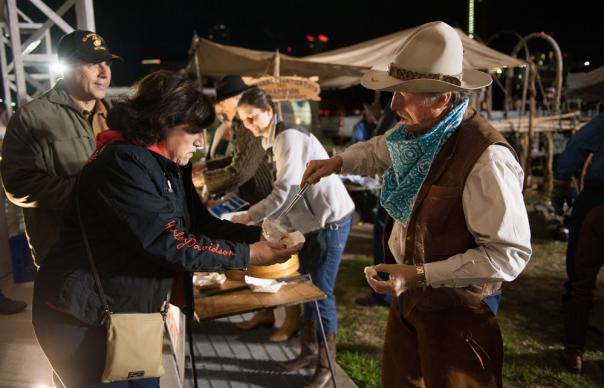A cowboy serves up the traditional cowboy breakfast at Rodeo Austin