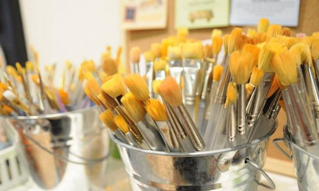 Paintbrushes in buckets