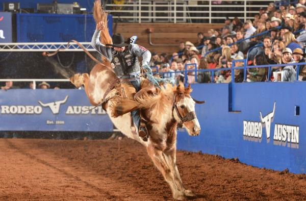 Rider participates in Saddle Bronc Riding event at Rodeo Austin
