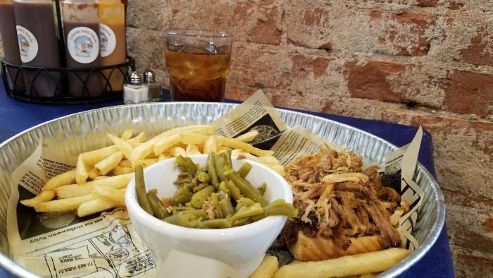 Pulled pork dinner with fries and green beans at Holy Smoke Hog Roast Company in Martinsville.
