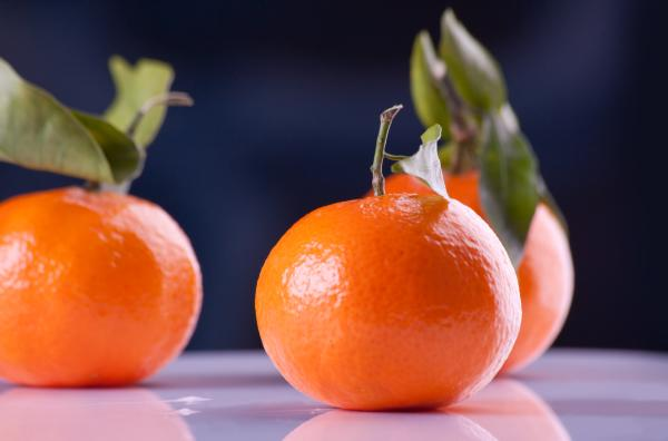 Use citrus - like satsumas - for a festive centerpiece.