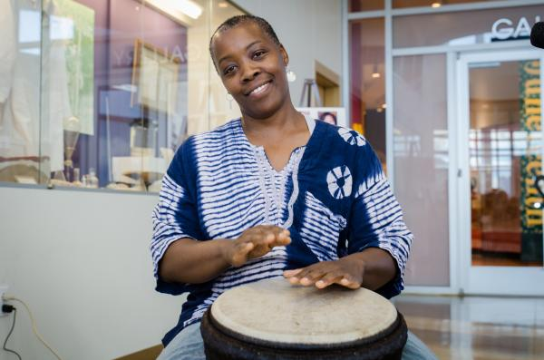 Woman playing drum at the George Washington Carver Museum