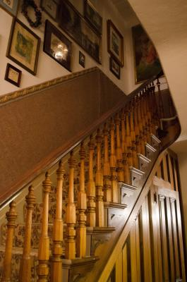 The original 1865 staircase still carries guests to the upper floors of the Twin Turrets Inn