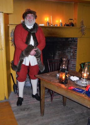 Volunteer dresses as 19th century depiction of Jolly St. Nick