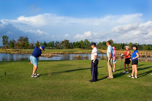 People Golfing