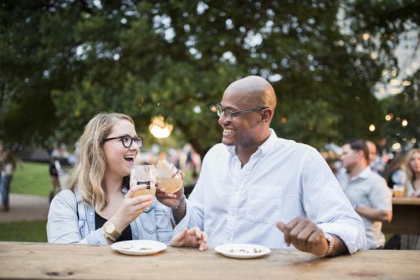 Festival-goers share a toast at the Austin Food + Wine Festival 2015