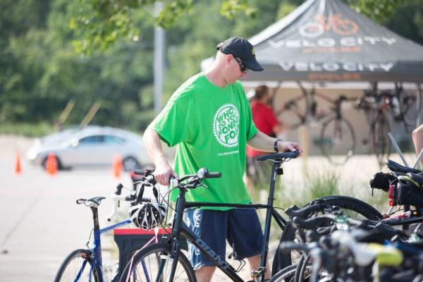 Gran Fondo volunteer with bike