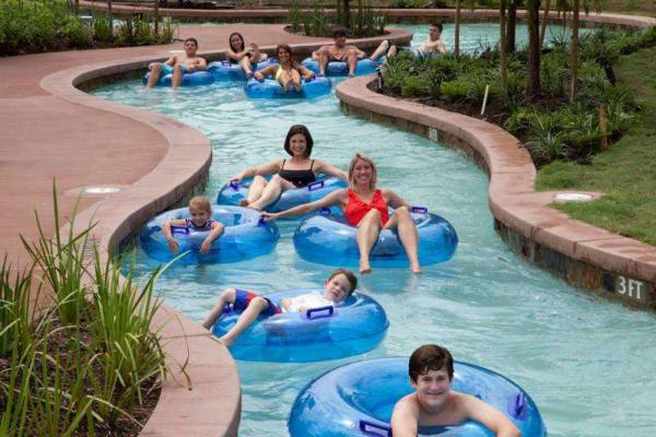 Park-goers floating down the lazy river at the Woodlands Resort
