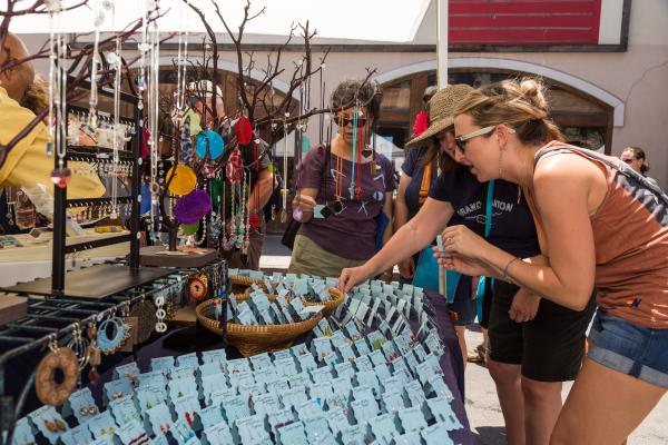 Ladies browsing jewelry at Pecan Street Festival