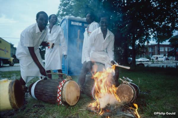 ©Philip Gould Rwanda Master Drummers heating skins befor`