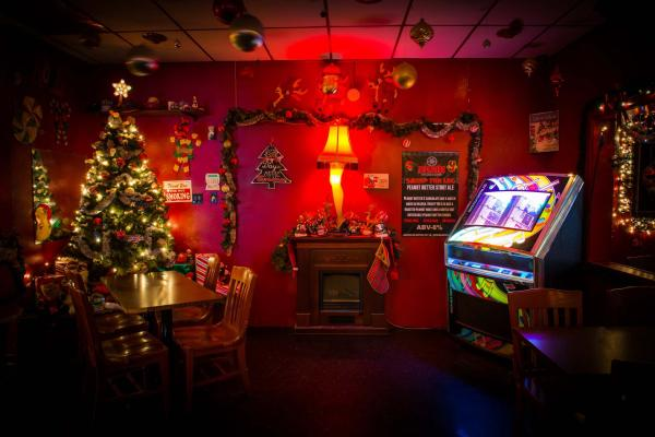dark bar interior with christmas tree and juke box