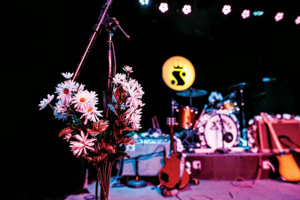 stage at sidewinder with flowers on mic