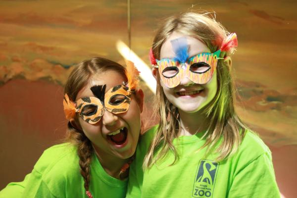 Two young girls dressed up at Zoo Camp