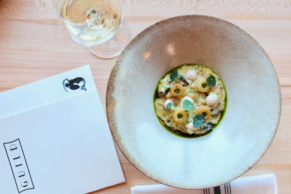 Oyster Sabayon and wine with menu at Guild restaurant in Austin Texas