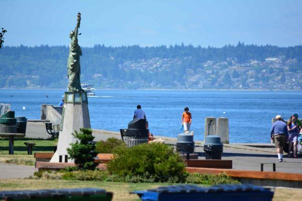 Small statue of liberty overlooking Alki Beach Park