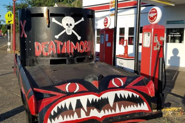 Deathmobile at the Service Station by Stephen Lawn