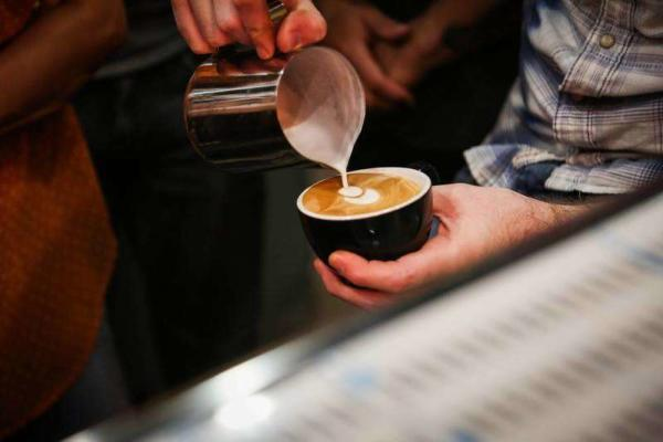 Pouring a Cup of Coffee at Cafeza