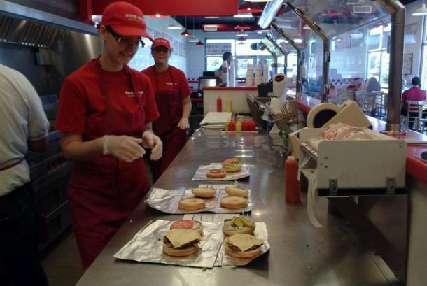 Five Guys Behind the counter