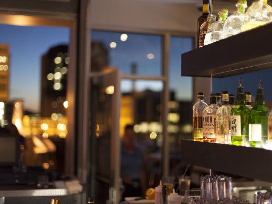 Patio bar combines indoor + outdoor spaces with a metropolitan vibe | credit olivejuicestudios.com