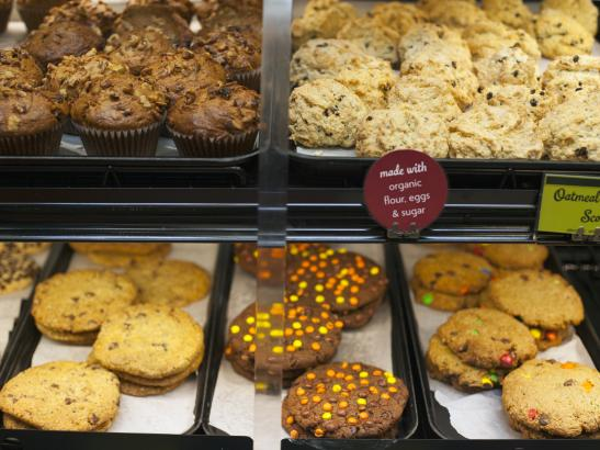 Grab and go case is stocked with an array of cakes, bars + cookies > credit olivejuicestudios.com.