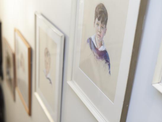 Family photos adorn the foyer walls | credit olivejuicestudios.com