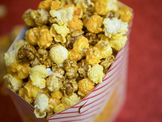 The best seller - a mix of regular, caramel, and cheddar popcorn > credit olivejuicestudios.com.