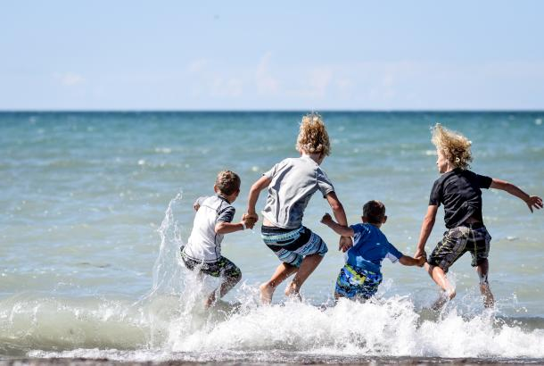 Kids diving into water at Erieau beach