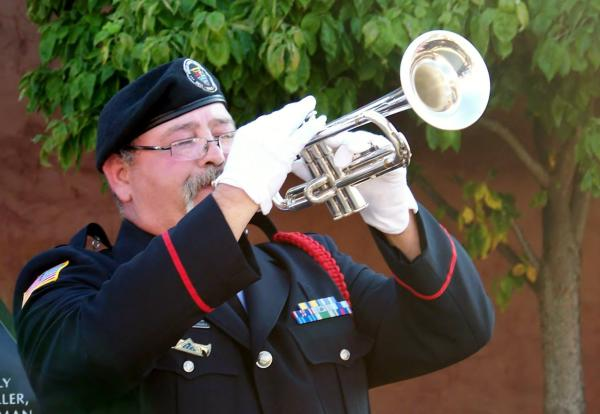 Bruce McKee plays live Taps on the Martinsville Square.