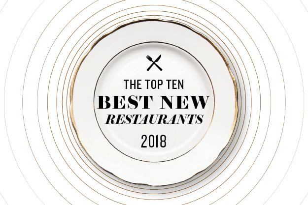 A white china plate with the words The top ten best new restaurants 2018 written on it