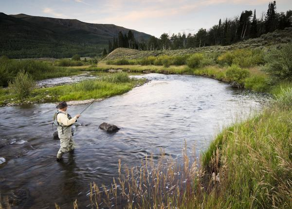 Fly Fisherman in the river near Park City